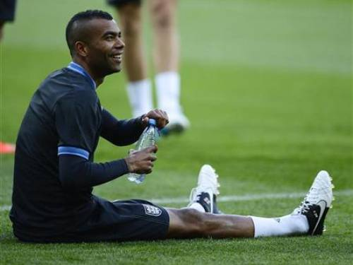England's national football player Ashley Cole watches during a training session ahead of their Euro 2012 match against Sweden at the Olympic stadium in Kiev June 14, 2012. REUTERS/Nigel Roddis