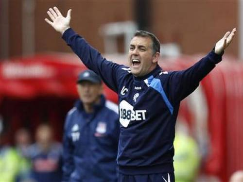 Bolton Wanderers manager Owen Coyle shouts at his players during his team's Premier League match against Stoke City at the Britannia Stadium in Stoke, May 13, 2012. REUTERS/Andrew Winning