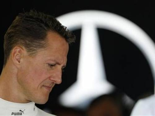 Mercedes Formula One driver Michael Schumacher of Germany stands inside his team garage during the first practice session of the Japanese F1 Grand Prix at the Suzuka circuit October 5, 2012. REUTERS/Kim Kyung-Hoon