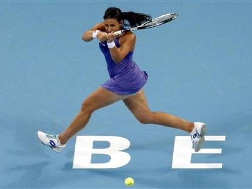 France's Marion Bartoli hits a shot during her women's singles semi-final match against Belarus' Victoria Azarenka at the China Open tennis tournament in Beijing October 6, 2012. REUTERS/David Gray