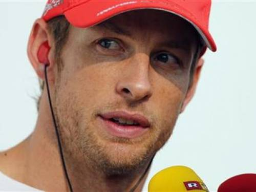 McLaren Formula One driver Jenson Button of Britain talks to the media after retiring due to a collision with Sauber Formula One driver Kamui Kobayashi of Japan during the South Korean F1 Grand Prix at the Korea International Circuit in Yeongam October 14, 2012. REUTERS/Bazuki Muhammad