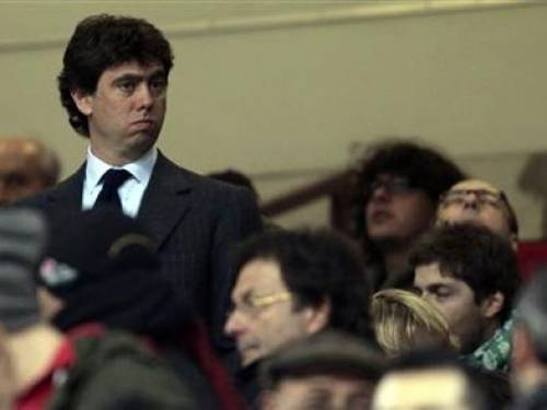 Juventus president Andrea Agnelli (L) stands at the tribune before the Italian Serie A soccer match against AC Milan at the San Siro stadium in Milan February 25, 2012. REUTERS/Stefano Rellandini