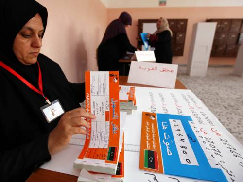 A Libyan polling station worker checks electoral material at a school in the Tajura district of Tripoli. (Getty)