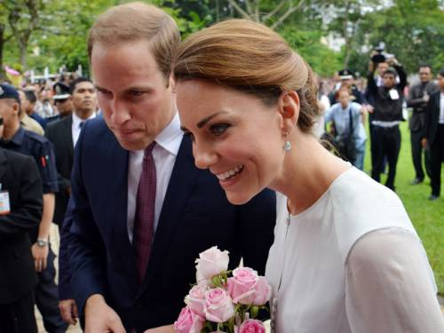 Britain's Prince William and his wife Kate speak to members of the public during a walk through a park in Kuala Lumpur, Malaysia. (AAP)