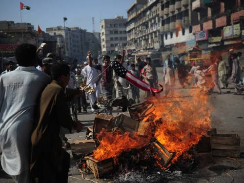 Pakistani Muslim demonstrators torch a US flag during a protest against an anti-Islam film in Karachi. (Getty)