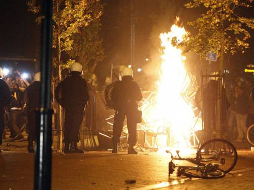 Riot police brakes up crowds of youths who turned violent in the northern Dutch town Haren, Netherlands. (AAP)
