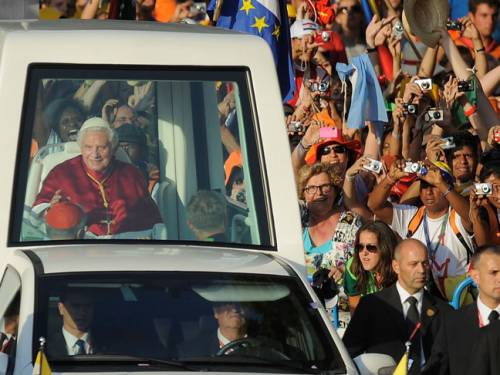 Pope Benedict XVI is welcomed by young pilgrims on arriving at Cibeles square during World Youth Day celebrations. (Getty)
