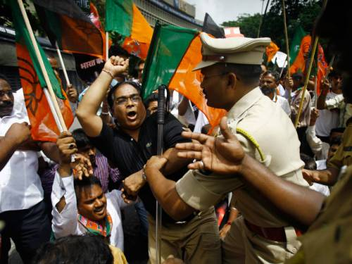 Indian policemen detain activists of the opposition Bharatiya Janata Party during a protest in Mumbai. (AP)