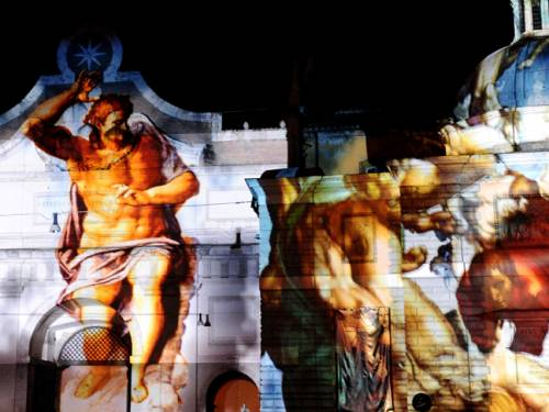 Visions of the apocalypse - Michelangelo's Last Judgment, projected on a Roman building. (AFP)