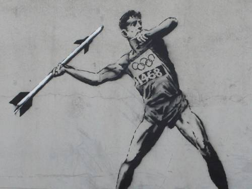 The first Olympic-themed mural, called 'Going for Mould' shows a javelin thrower getting ready to throw a missile. (www.banksy.co.uk)