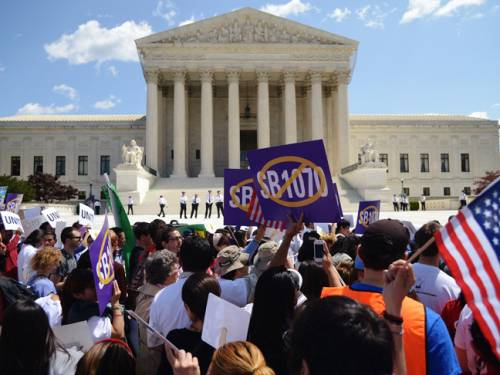 More than 1,000 protesters outside the court lashed out against provisions of the law, known as SB1070. (Getty Images)