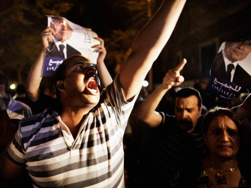 Around 1,000 demonstrators had gathered on Monday in Cairo's central Tahrir Square to protest Shafiq's presence on the runoff ballot after election officials announced the results of the first-round poll. (Getty)
