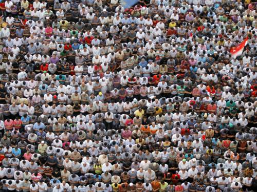 Prayer time on Tuesday as Tahrir square is again filled with  protesters, this time supporters of Mohammed Mursi. (AAP)