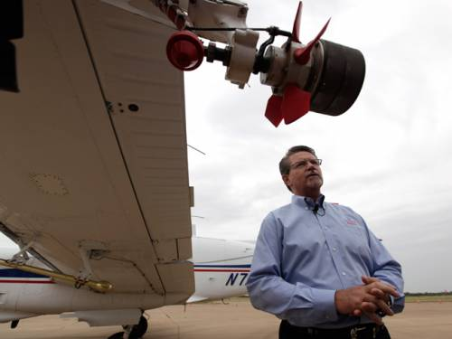 Mike Stuart of Dynamic Aviation describes the plane involved in the aerial spraying process. (AAP)