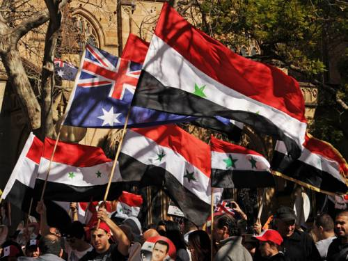Demonstrators march in Sydney in support of President Bashar al-Assad and against the intervention of foreign powers in Syria. (AAP)