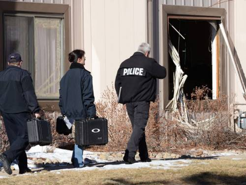 Aurora Police Crime Scene Detectives prepare to enter a townhouse in Aurora, Colorado. (EPA)