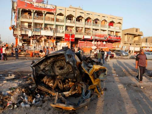 People inspect the aftermath of an overnight car bomb attack in Baghdad's Shiite enclave of Sadr City, Iraq. (AAP)