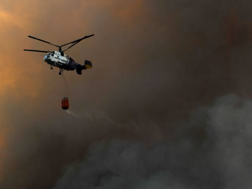 Four people have been killed and 23 injured after bush fires swept through the Catalonia region of Spain. (Getty Images)