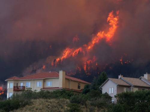 The fire - which destroyed 300 homes and forced some 36,000 people to evacuate - is just 15 percent contained. (Photo: AP)