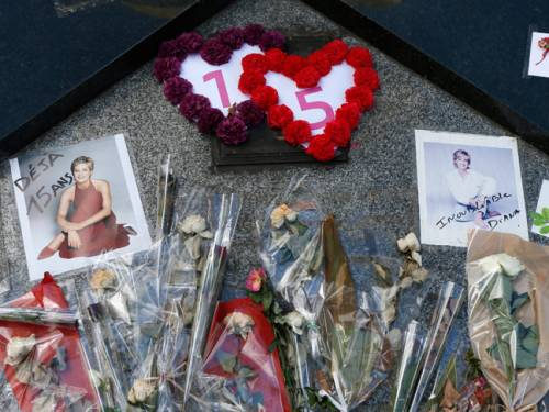 Tributes are laid down under the Flame of Freedom statue at the Pont de l'Alma underpass in Paris, where Lady Diana died. (Getty)