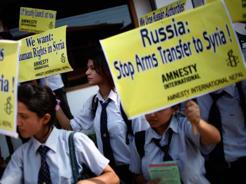 Nepalese students hold placards during a protest against the human rights violation in Syria, organised by Amnesty International. (AP Photo/Niranjan Shrestha)