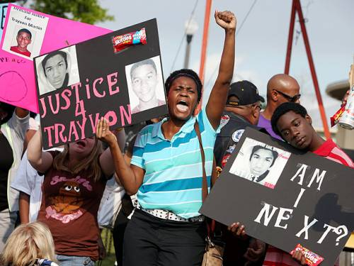 Protesters at a rally for Trayvon Martin, the black teenager who was fatally ...