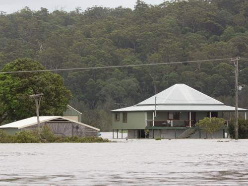 Flooding isolates about 4000 people on the New South Wales north coast. (AAP)