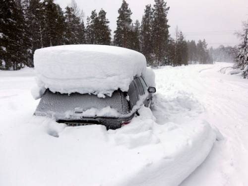 A middle-aged Swedish man was found alive in this car after being trapped by snow for at least two months. (EPA)