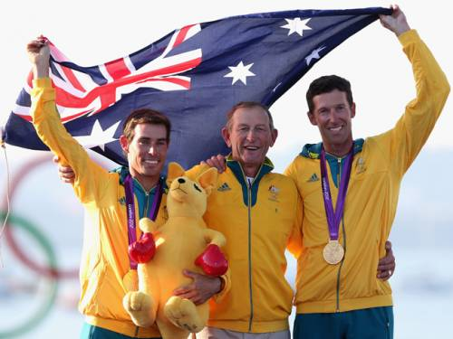Mathew Belcher and Malcolm Page celebrate their win with their coach Victor Kovalenko. (AAP)