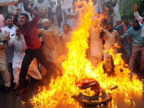 In Pakistan, thousands of students burned US flags and chanted anti-American slogans in the northwestern city of Peshawar. (Getty)