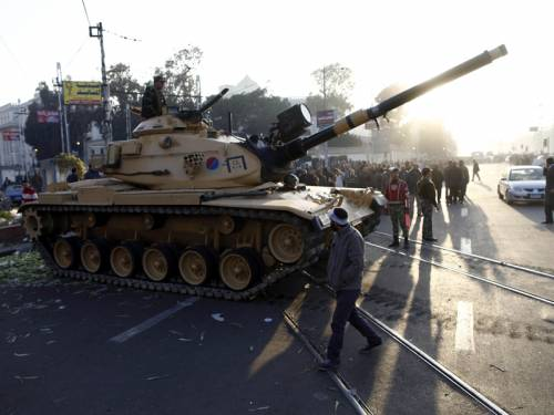The Egyptian army has moved in to restore order after violent protests in Cairo escalated. (AAP)