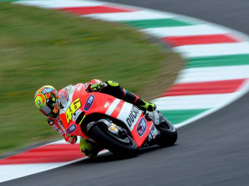 Valentino Rossi (pic) says he can work with rival Jorge Lorenzo when he rejoins him at Yamaha. (AAP)