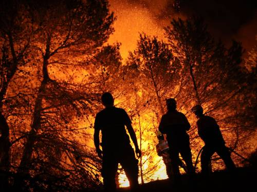Thousands of people have fled their homes as fires rage across Spain's Canary Islands. (AAP)