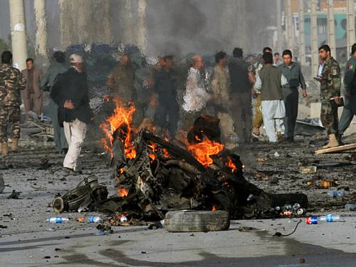 A female suicide car bomber has attacked a van in Kabul, killing 12 people. (AAP)