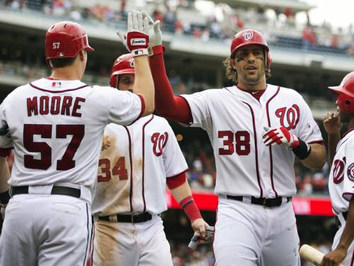 The Nationals clinched the top seed in the MLB's National League with a 5-1 rout of the Phillies. (AAP)