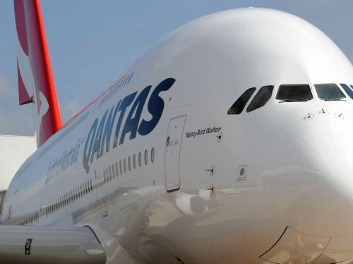 Qantas' CEO says the airline is taking its time to form an alliance with a major overseas carrier. (AAP)