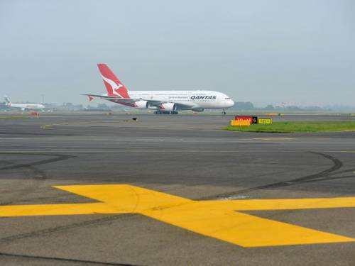 Qantas has flagged a statutory loss after a hit from high fuel bills and restructuring. (AAP)