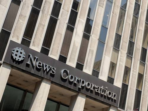 Rupert Murdoch's media giant News Corporation has suffered a 55 per cent full year earnings slide. (AAP)