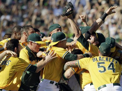 The Oakland Athletics routed the Texas Rangers 12-5 to secure MLB's American League West title. (AAP)