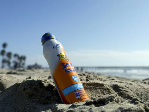 The maker of Banana Boat sunscreen is recalling 500,000 bottles of lotion over a fire risk. (AAP)