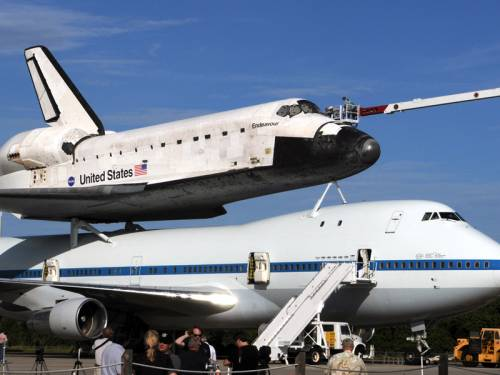 Bad weather is delaying the transfer of space shuttle Endeavour from Florida to California. (AAP)