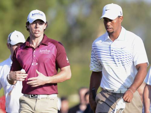 Rory McIlroy (L) and Tiger Woods will open their 2013 campaigns at the Abu Dhabi Golf Championship. (AAP)