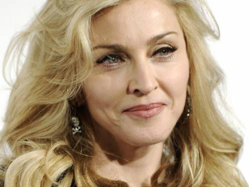 Pop singer Madonna (pic) has urged fans to vote for Barack Obama in America's November election. (AAP)