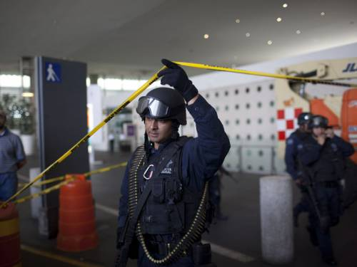 Gunmen shot dead three policemen on an anti-drug operation at Mexico City's international airport. (AAP)