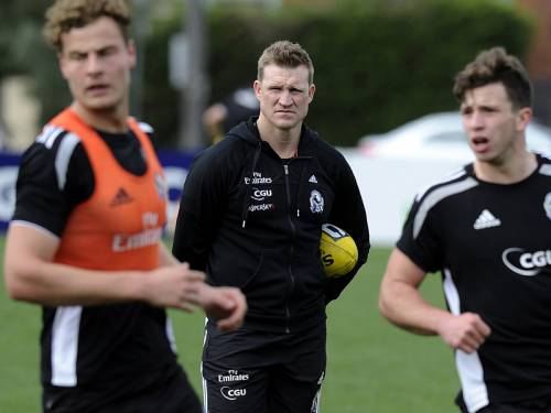 Collingwood coach Nathan Buckley says he is wary of his players being emotionally overloaded. (AAP)