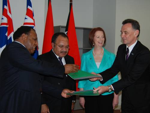 Australia and PNG have signed an agreement to allow asylum seekers to be processed in PNG. (AAP)