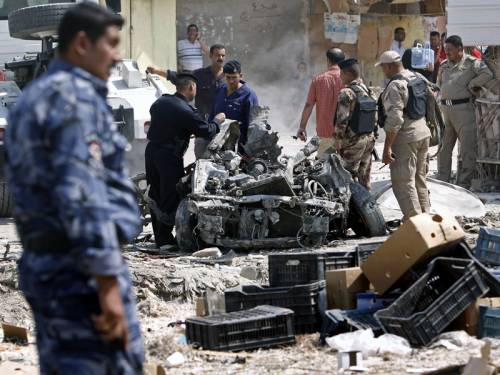 In Baghdad, a suicide bomber detonated an explosives-packed car in the central Karrada district, targeting the deputy head of police for the area, a police officer at the scene said. (File: AAP)