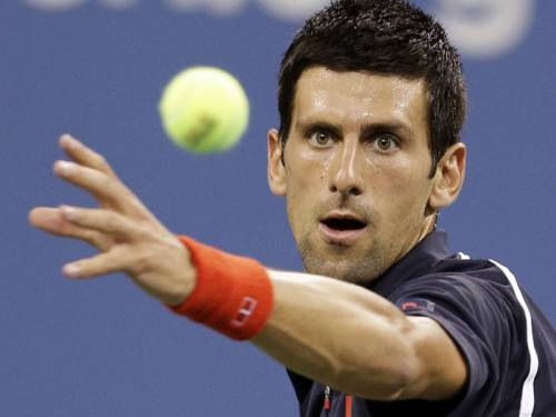 Novak Djokovic (pic) opened his US Open title defence with a 6-1 6-0 6-1 thrashing of Paolo Lorenzi. (AAP)