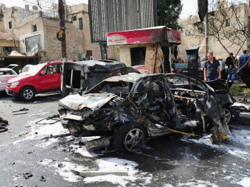 A car bomb outside a police station has rocked Syria's capital Damascus, killing 13 people. (AAP)