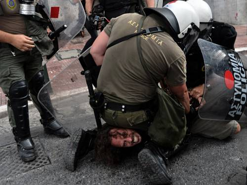 Police clashed with protesters on the streets of Athens during a visit by the German Chancellor. (AAP)